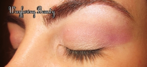 Use Magic (the pink shade with gold shimmer) to the crease, extending it out past the eye in a wing.